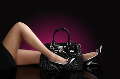 Fashionable woman with a black bag Royalty Free Stock Image