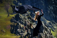 Fashionable woman with black dress outdoor Stock Photo