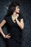 Fashionable woman in black dress. Studio shot. Stock Photos