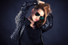 Fashionable woman in a black jacket Stock Photos