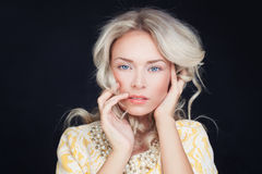 Fashionable Woman with Blonde Curly Hair Royalty Free Stock Photo