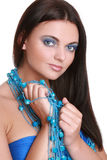 Fashionable woman with blue beads Royalty Free Stock Image