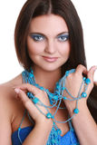 Fashionable woman with blue beads Royalty Free Stock Photography