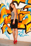 Fashionable woman with a blured graffitti in background Stock Images
