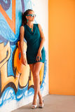 Fashionable woman with blured graffitti in background Stock Image