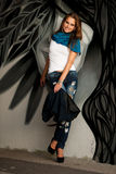 Fashionable woman with blured graffitti in background Stock Images