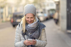 Fashionable Woman Busy with Phone at City Street stock photos