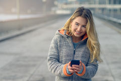 Fashionable Woman Busy with Phone at City Street stock image