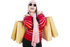 Fashionable woman carrying shopping bags Stock Images