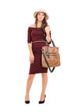 Fashionable woman carrying a trendy bag Stock Photos
