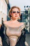 Fashionable woman on city street royalty free stock photos