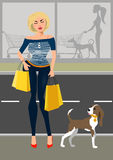 Fashionable woman with a dog near the shop. Fashionable woman with her purchases a dog near the shop Royalty Free Stock Image