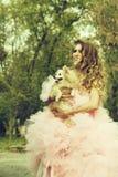 Fashionable woman with dog stock photos