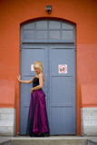 Fashionable woman in doorway Royalty Free Stock Photo
