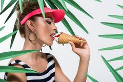 Fashionable woman eating ice cream Stock Images