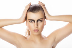 Fashionable woman face with art makeup at studio on white backgr. Fashionable young woman face with art makeup at studio over a white background Stock Photo