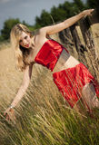 Fashionable woman in field Royalty Free Stock Image