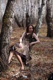 Fashionable woman in forest Stock Photo