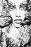 Fashionable woman in fur coat Stock Photography