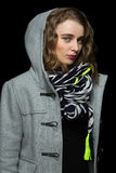 Fashionable woman in a grey hooded coat Royalty Free Stock Photography