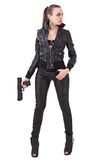 Fashionable woman with a gun Stock Image