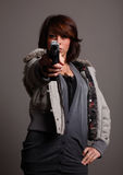 Fashionable woman with gun Stock Photo