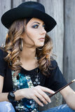 Fashionable woman is in hat Royalty Free Stock Photos