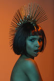 Fashionable woman in headpiece with facial expression Royalty Free Stock Image