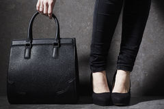 Fashionable woman in heels with bag Stock Photo