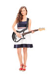 Fashionable woman holding an electric guitar Royalty Free Stock Images