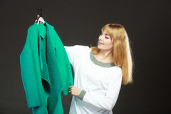 Fashionable woman holding green coat Royalty Free Stock Photo