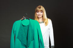 Fashionable woman holding green coat Royalty Free Stock Images