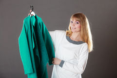 Fashionable woman holding green coat Stock Photos