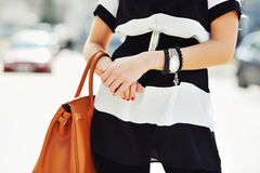Fashionable woman holding a handbag in hands - close up Royalty Free Stock Photography