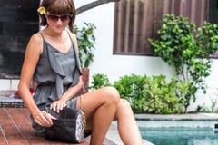 Fashionable woman holding luxury stylish snakeskin python bag. Elegant outfit. Close up of purse in hands of stylish Stock Photos