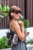 Fashionable woman holding luxury stylish snakeskin python bag. Elegant outfit. Close up of purse in hands of stylish Stock Photo