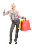 Fashionable woman holding shopping bags Stock Photos