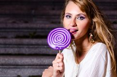 Fashionable woman with huge lollipop Royalty Free Stock Image