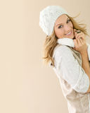 Fashionable woman iin winter clothing smiling and posing Royalty Free Stock Image