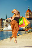 Fashionable woman jumping with shopping bags Stock Images