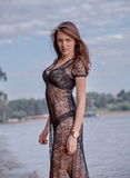 Fashionable woman by lake Royalty Free Stock Photo