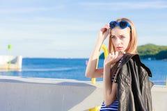 Fashionable woman in marina Stock Photo