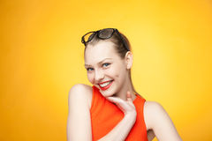 Fashionable woman in orange dress and glasses Stock Photography