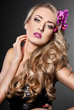 Fashionable woman with orchid Royalty Free Stock Photo