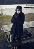 Fashionable woman, outdoor posing in March Stock Image