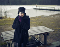 Fashionable woman, outdoor posing in March Royalty Free Stock Photos