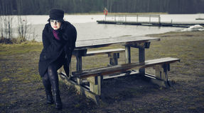 Fashionable woman, outdoor posing in March Royalty Free Stock Photography