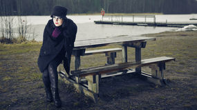 Fashionable woman, outdoor posing in March Royalty Free Stock Image