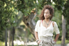 Fashionable woman in the park Stock Photos