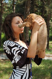 Fashionable woman with pet dog Stock Photography
